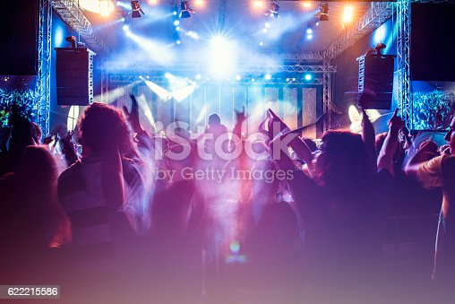 istock Psychedelic concert crowd 622215586