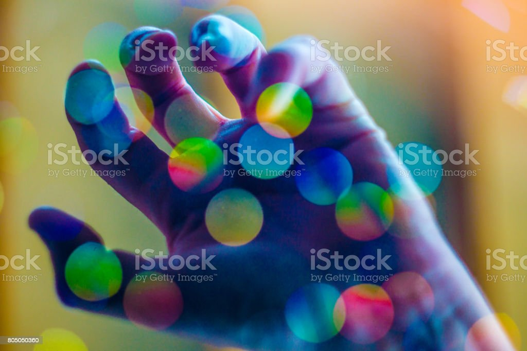 Psychedelic Hand Grasping Drug Trip Concept stock photo