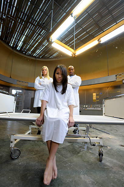 psychiatric patient and guarding nurses xxxl image - psychiatric ward stock photos and pictures