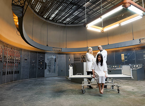 psychiatric patient and nurses in surreal environment - psychiatric ward stock photos and pictures