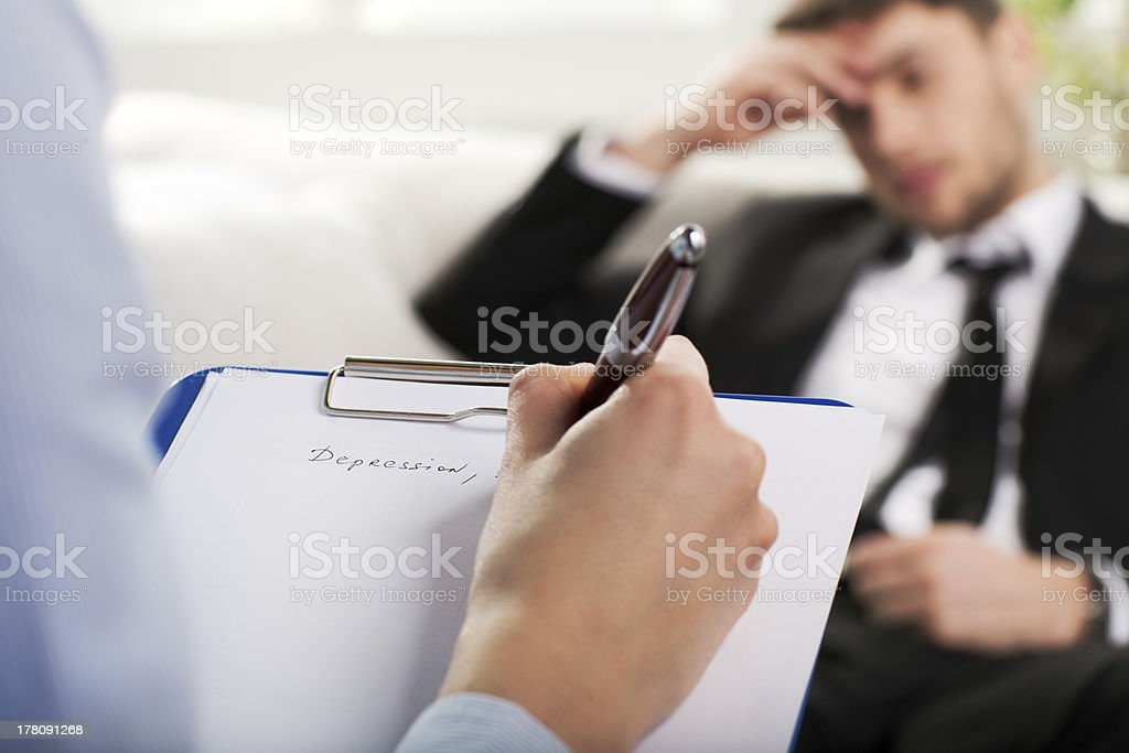 psychiatrist examining a male patient royalty-free stock photo