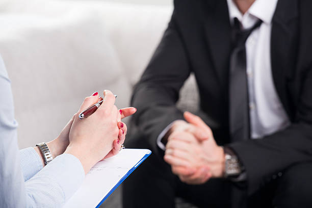 psychiatrist examining a male patient stock photo
