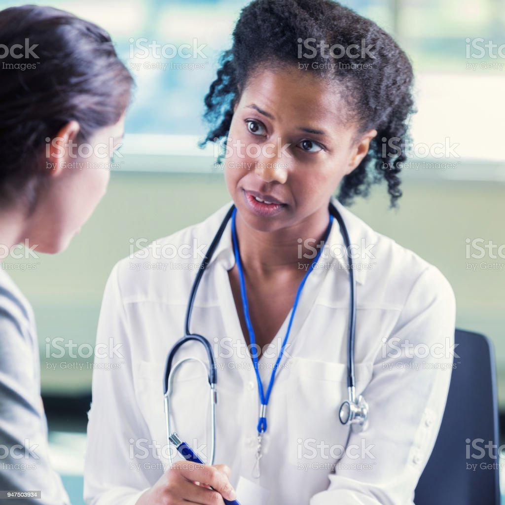 Psychiatrist listens attentively to client stock photo