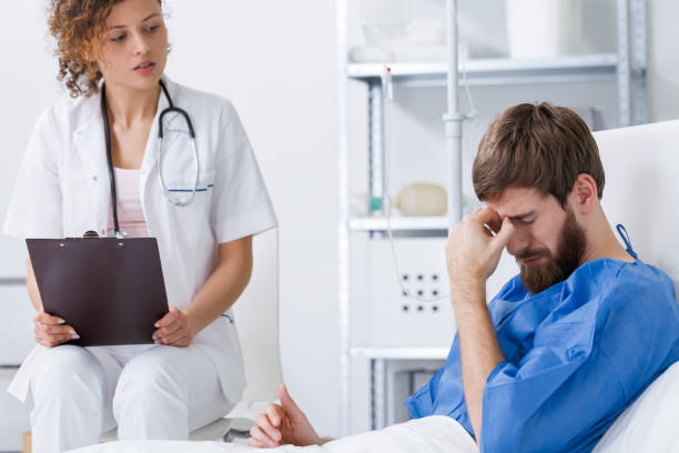 psychiatrist supporting depressed patient - psychiatric ward stock photos and pictures