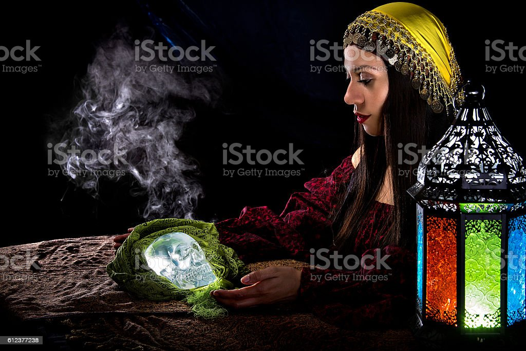 Psychic Holding a Crystal Skull stock photo