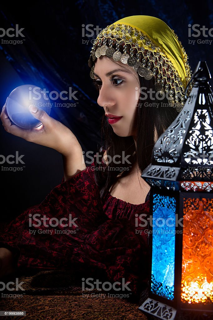 Psychic looking into crystall ball stock photo