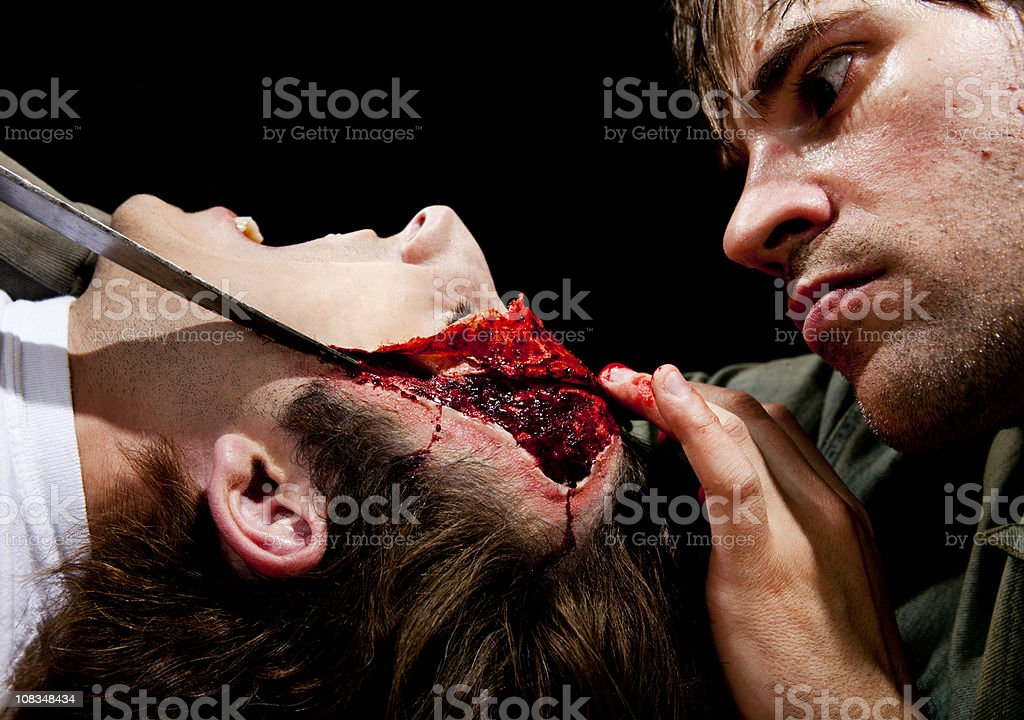 Psycho Killer Cutting Victims Face off stock photo