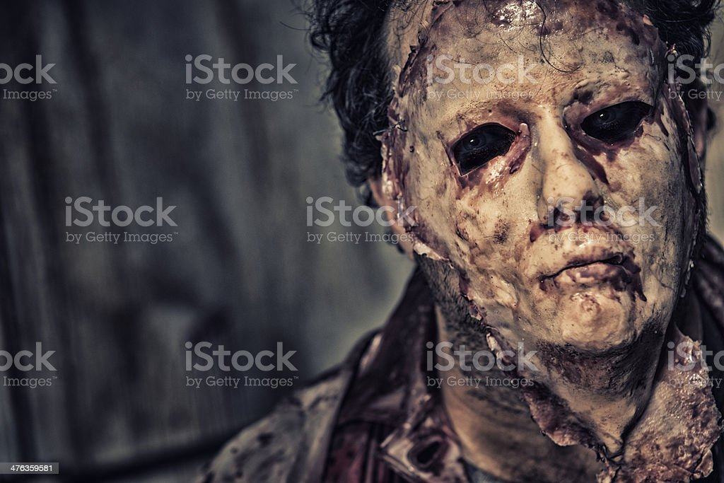 Psycho Killer with a skinned face mask stock photo