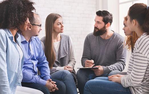 istock Psychologist asking members of rehab group about their addictions 1162526212