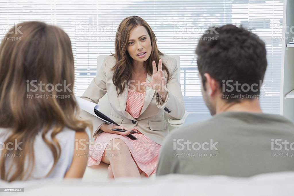 Psychologist discussing with a couple stock photo