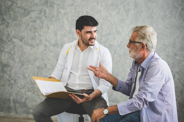 Psychologist doctor discussing with patient stock photo
