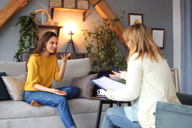 Psychologist having session with her female patient stock photo