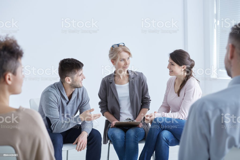 Psychologist helping his patients stock photo