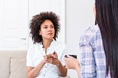 istock Psychologist listening to her patient and writing notes, mental health and counseling. Psychologist consulting and psychological therapy session concept 1250010710