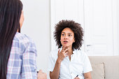 istock Psychologist listening to her patient and writing notes, mental health and counseling. Psychologist consulting and psychological therapy session concept 1250010720