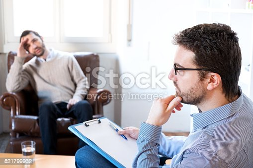 istock Psychologist taking notes during psychotherapy session 821799932