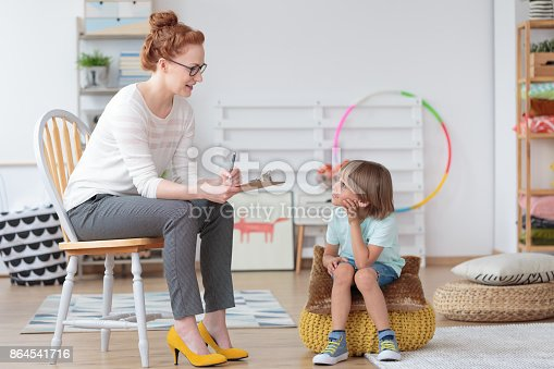 istock Psychologist talking with little boy 864541716