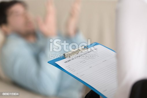 istock Psychologists office, female practitioner holding clipboard with medical patient card 669015904