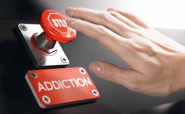 Psychology concept, Stop Addiction or Dependence Woman pressing a panic button with stop sign to overcome addiction or dependence problems. Psychology concept. dependency stock pictures, royalty-free photos & images