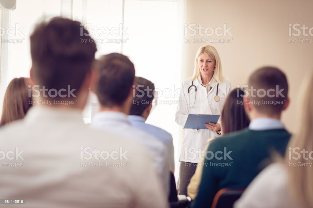 Psychology professor and students in classroom stock photo
