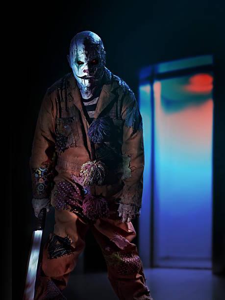 psychopath criminal clown in horror house stock photo