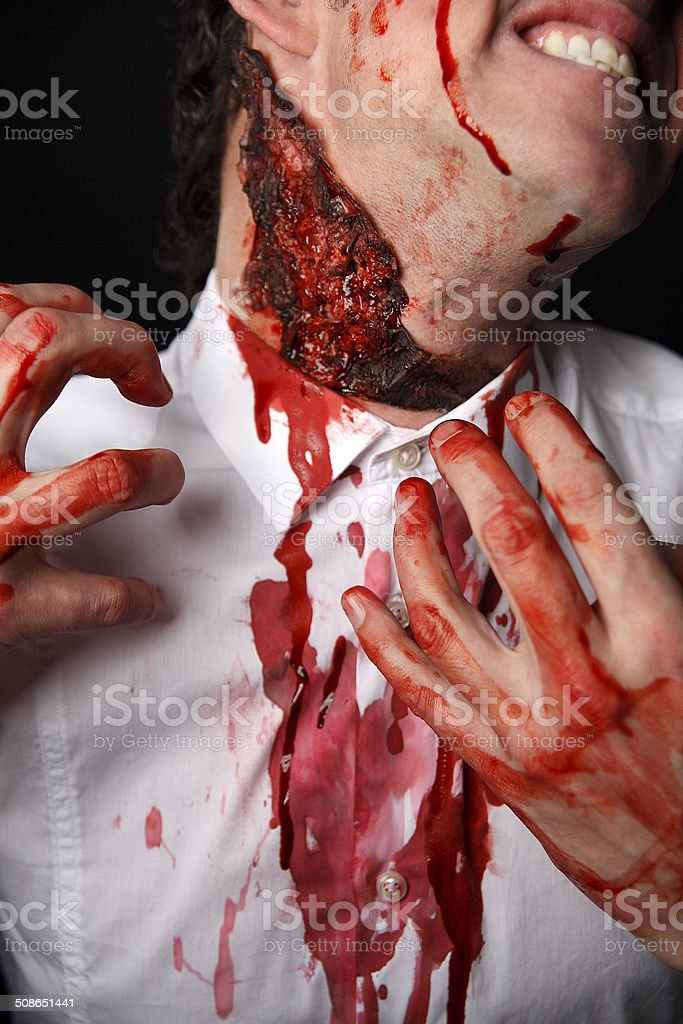 Psychopath with bloody fingers stock photo