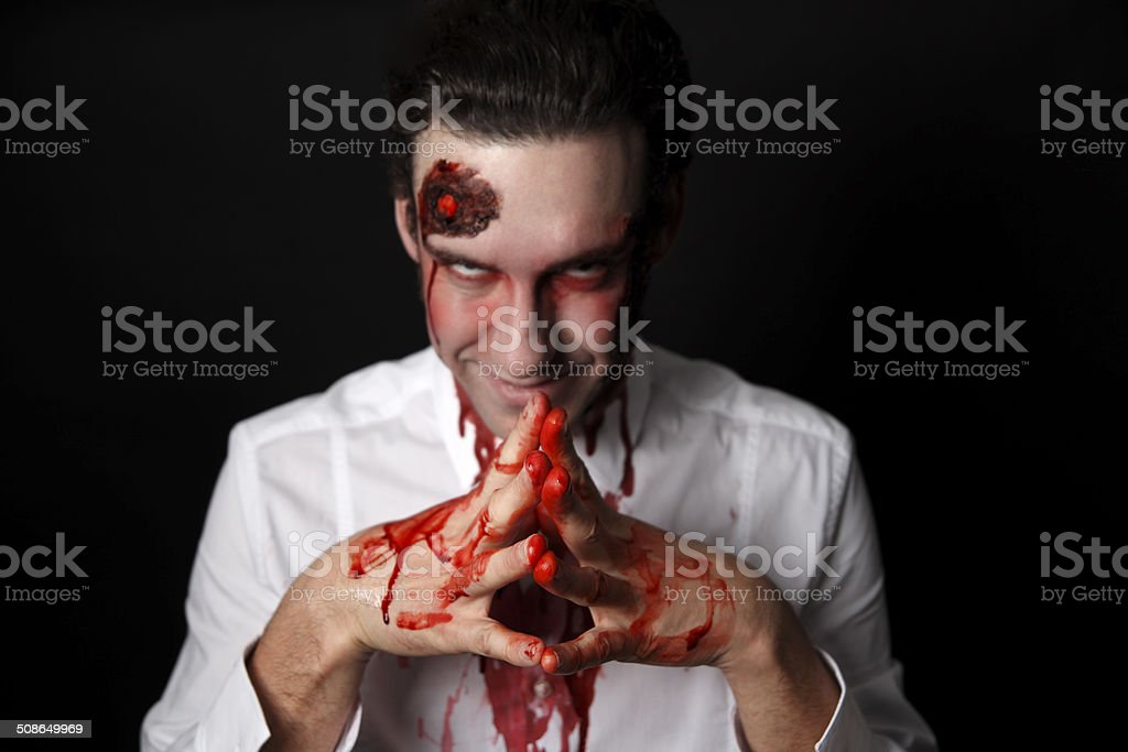 Psychopath with bloody hands stock photo