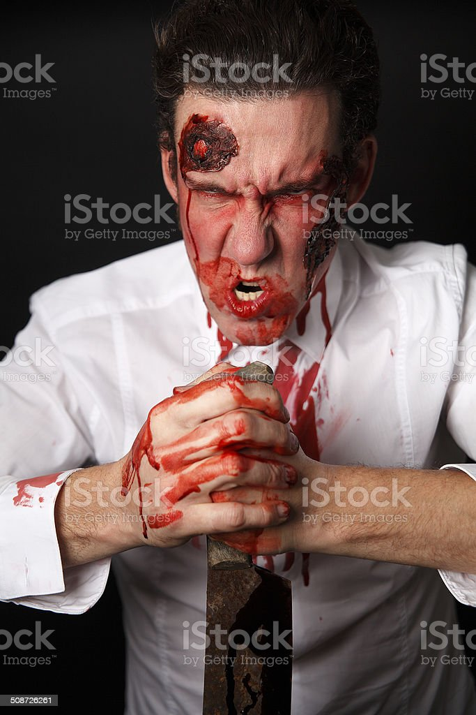 Psychopath with bloody knife stock photo