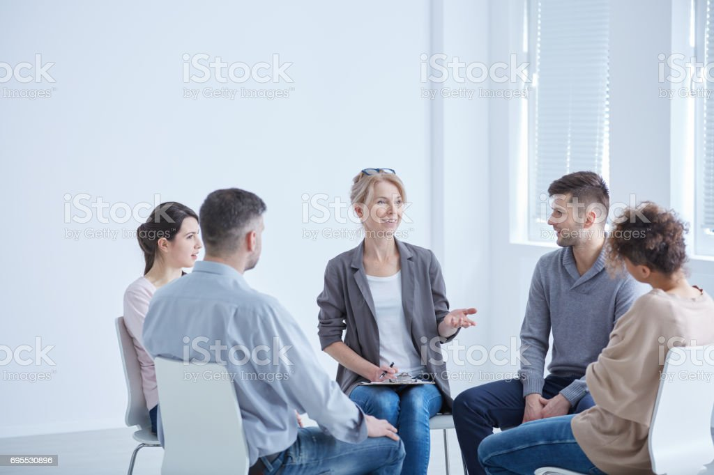 Psychotherapist and group stock photo