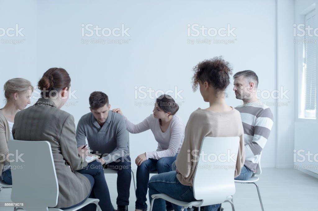 Psychotherapist comforting man Psychotherapist comforting man with depression during psychotherapy meeting Addiction Stock Photo