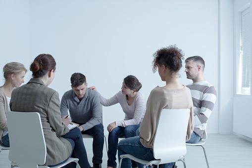Psychotherapist Comforting Man Stock Photo - Download Image Now