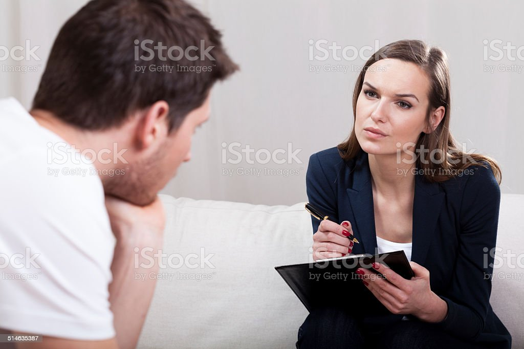 Psychotherapy session interview stock photo