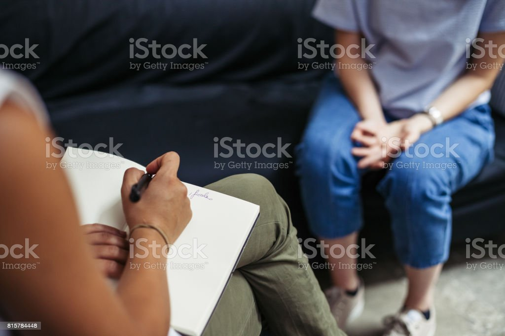 Psychotherapy session, woman talking to his psychologist in the studio stock photo
