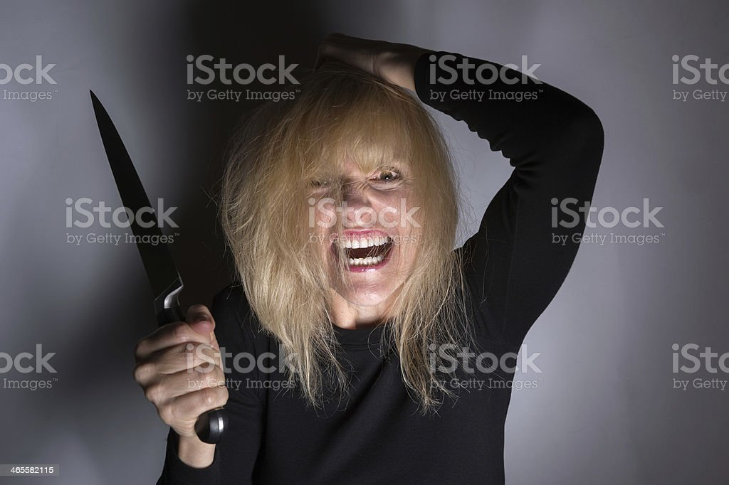 Psychotic Woman with Knife royalty-free stock photo