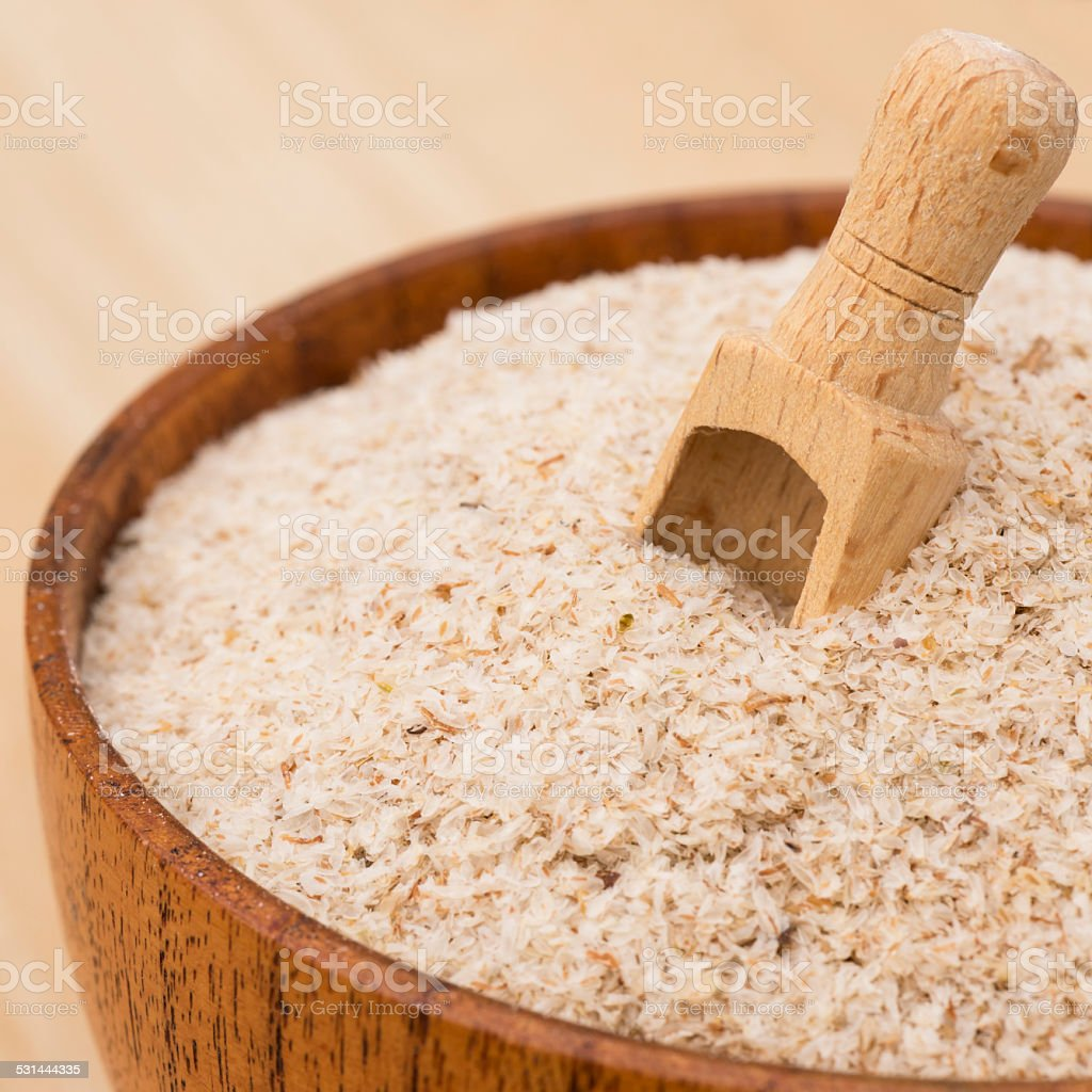 Psyllium Seeds in a bowl on wooden background stock photo