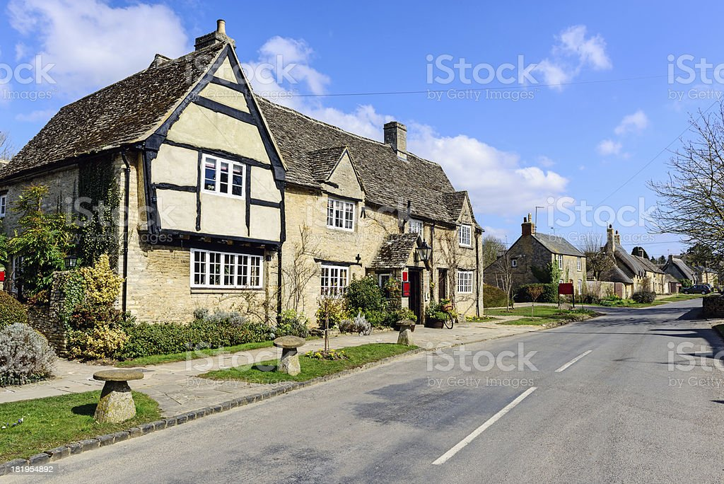 Pub and Village in the Cotswolds, England stock photo