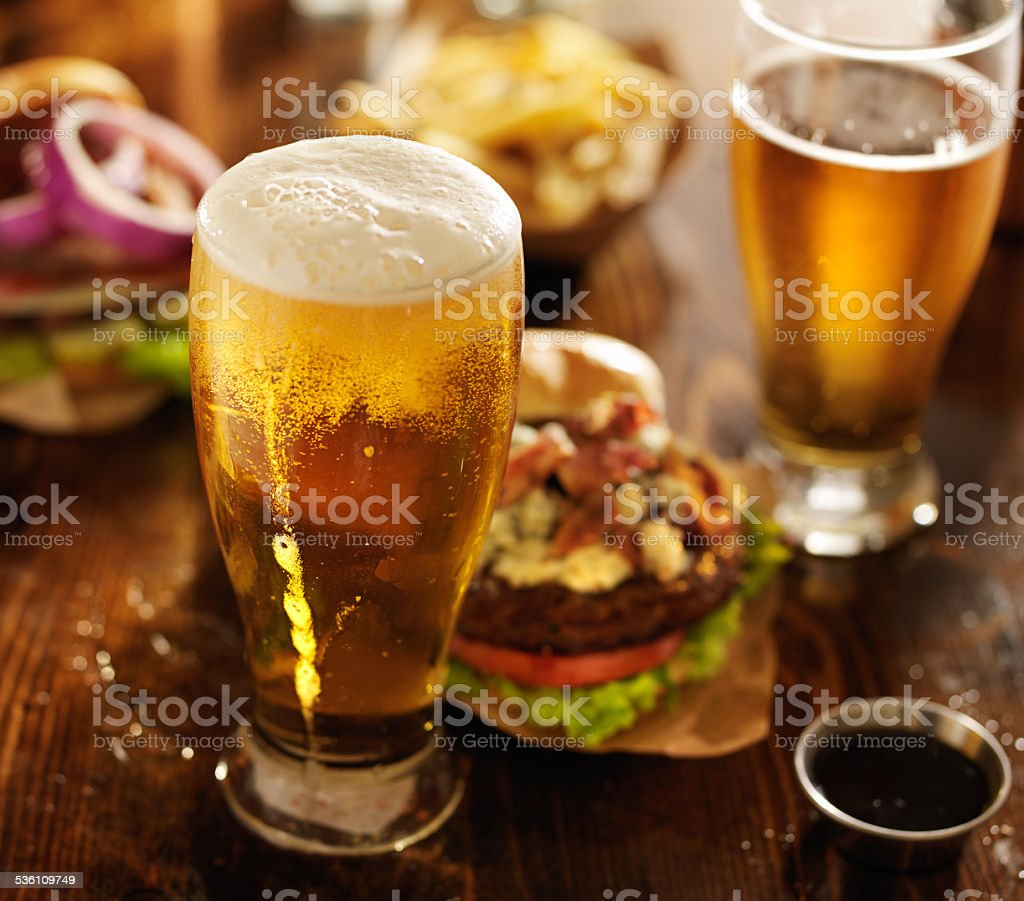 pub food - beer and burgers stock photo