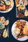 Various pub food on a restaurant table.