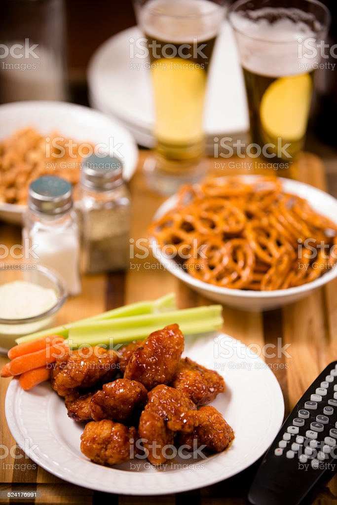 Pub food. Snacks, beer. Appetizers. Spicy chicken wings. stock photo
