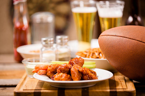 pub food. snacks, beer, football. spicy chicken wings. - animal wing stock photos and pictures