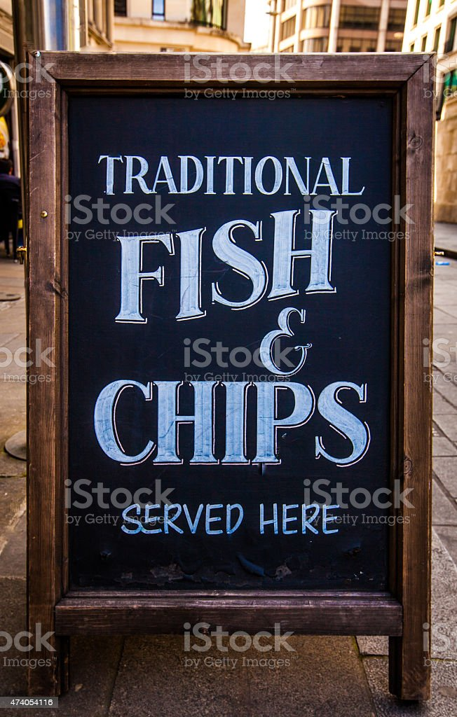 Pub sign advertising Fish and Chips in City of London stock photo