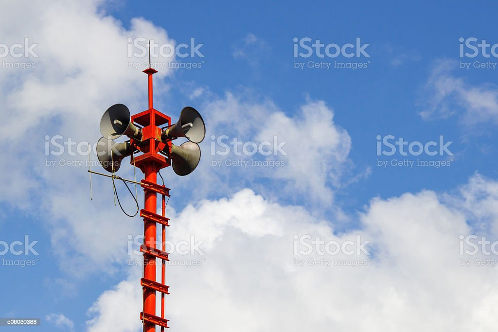 Public Address system speakers in blue sky stock photo