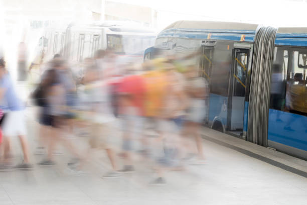 Public and modern transportation Passangers getting off a BRT bus bus rapid transit stock pictures, royalty-free photos & images