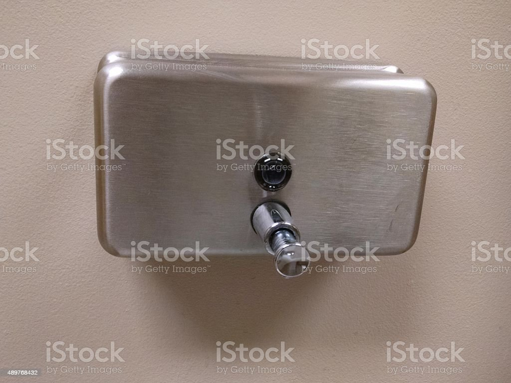 Public bathroom Soap dispenser stock photo
