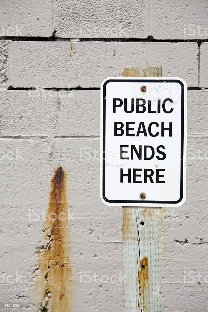 Public beach ends here sign royalty-free stock photo