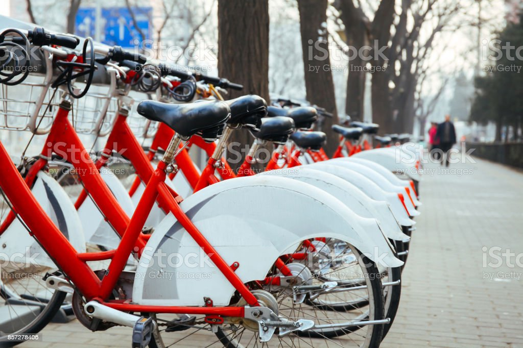 Public Bike Rental Station in Beijing, China with Bicycles arranging in row ready for public rental stock photo