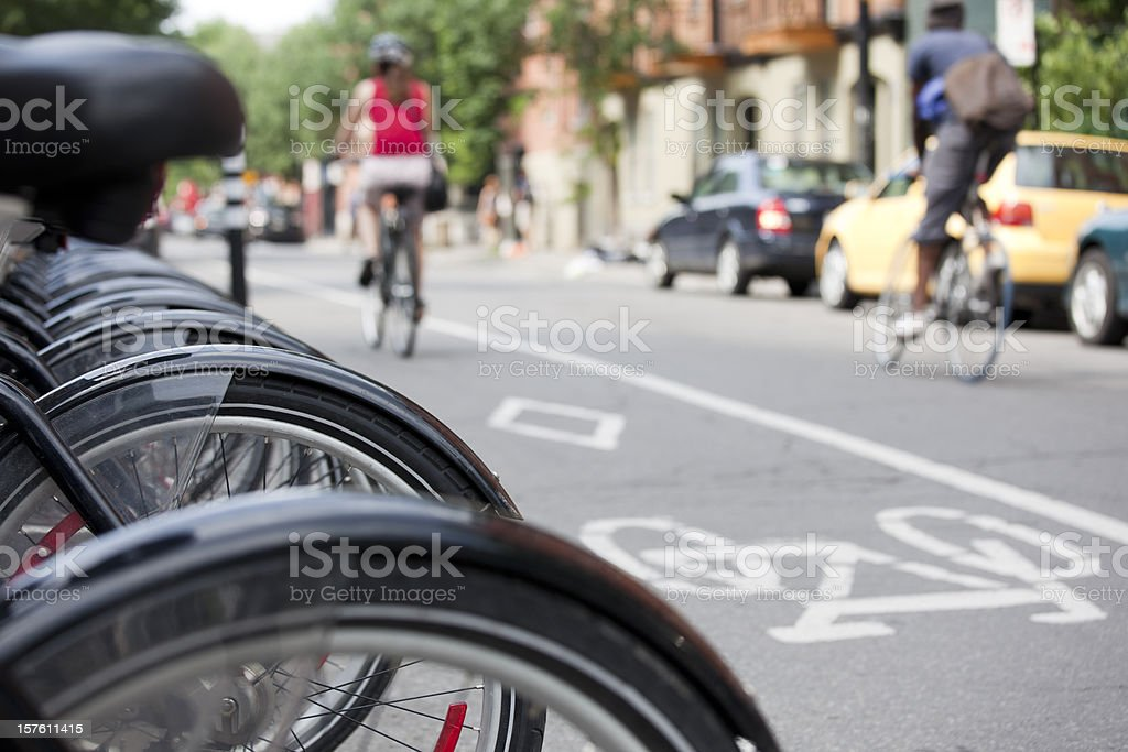 Public bike rental system and bicycle rider commuters, Montreal stock photo
