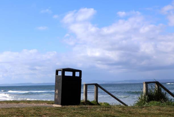 Public bin by the beach stock photo