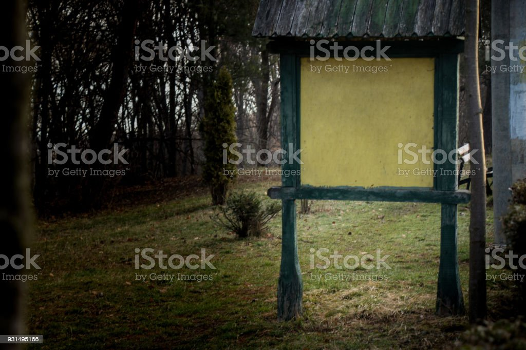 Public board in the forest stock photo