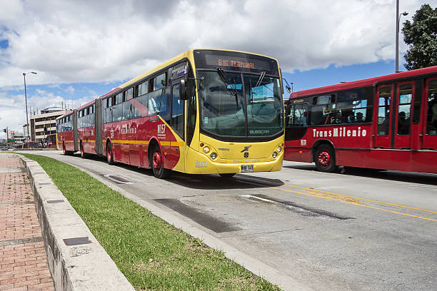 """Public Bus at Bogota. Bogota, Colombia - May 5, 2016: Bus cars of the massive transport system known as """"transmilenio"""" at Bogota, Colombia. bus rapid transit stock pictures, royalty-free photos & images"""